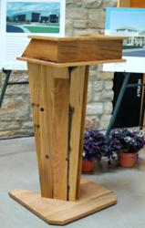 Crafted of white oak staves reclaimed from wine vats used at a Finger Lakes winery, the FLCC Student Center podium meets environmentally conscious requirements and offers rich history.